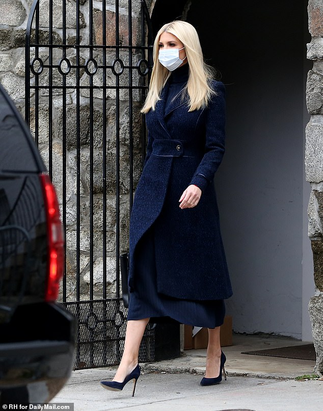 Full look: Ivanka paired her navy coat with a matching turtleneck and matching midi skirt