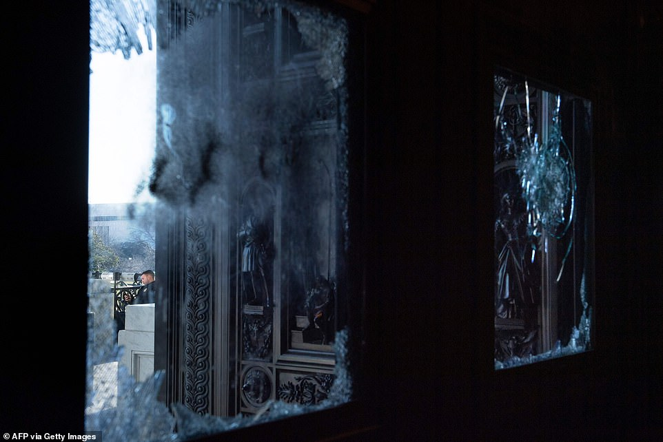 Shattered windows, damaged furniture and ransacked offices form the scene of the aftermath of destructive riots