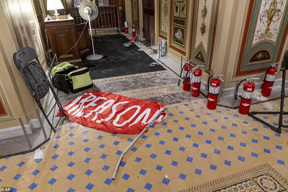 Elsewhere in the building, a large cloth sign with the words ¿treason¿ was left on the floor of a hallway