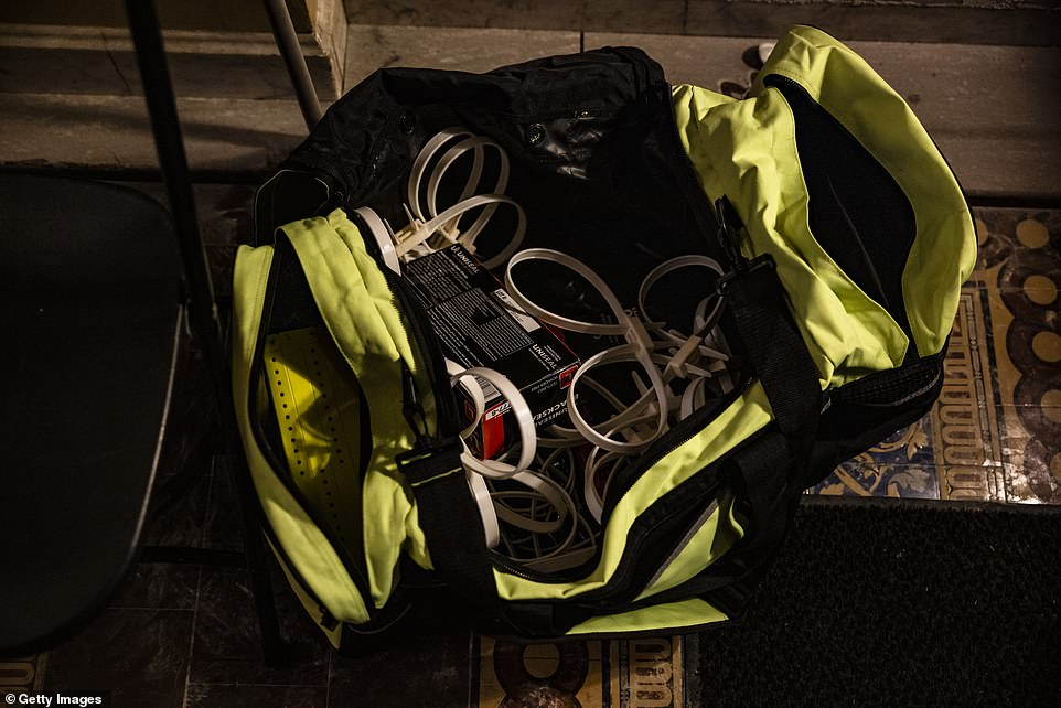A duffle bag of flex cuffs remains at the northern entrance door