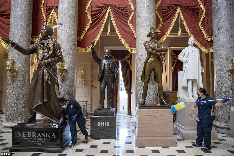 They were observedpicking up shards of glass from the Capitol floor and polishing vandalized statues