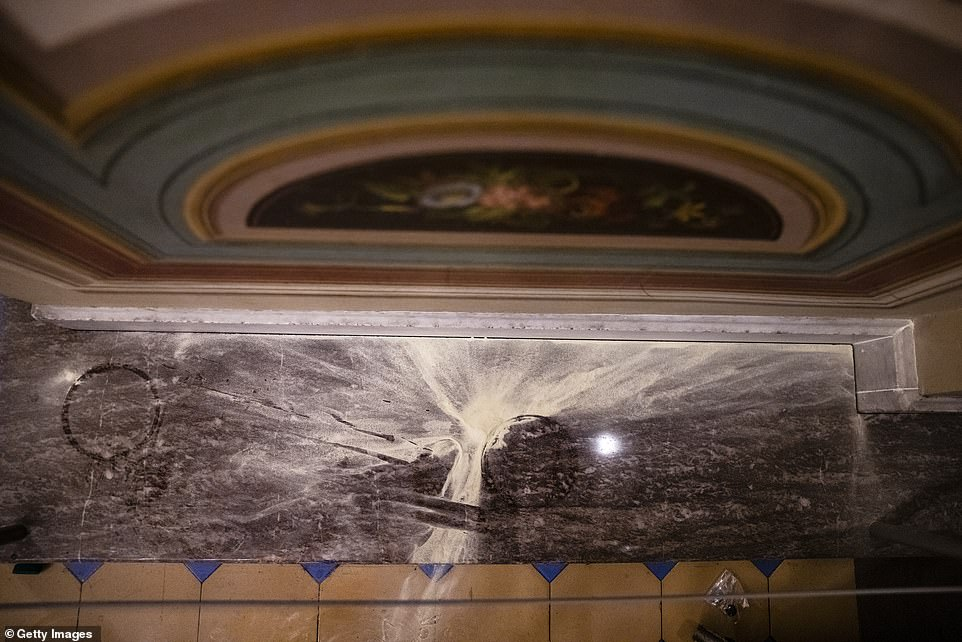 Remnants from a chemical irritant are seen on the floor of the Capitol in the above image