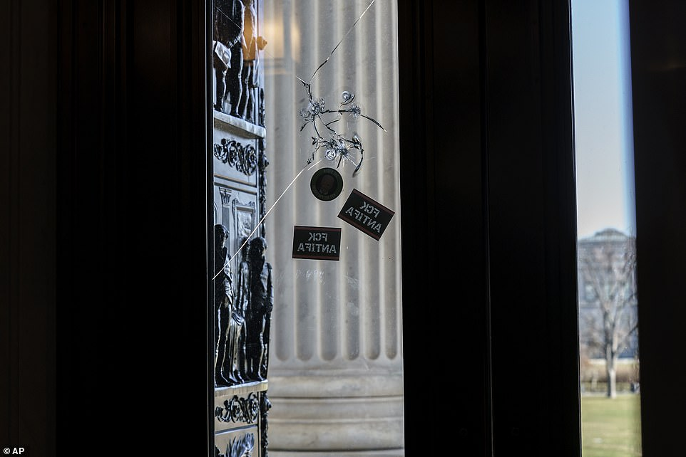 Damage to the doorway leading to the House chamber is seen on Thursday