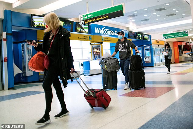 The new rules mean travellers will have to quarantine for ten days – even if they test negative – if arriving from a 'red list' country with high rates of Covid-19. Pictured, passengers arriving in New York on a flight from London