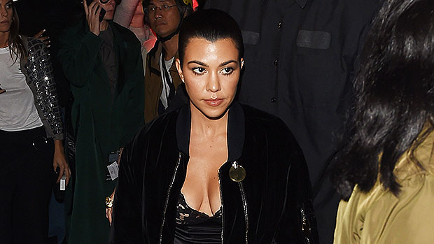 Kourtney Kardashian Sizzles In Black Mini Dress & Knee-High Stockings For 'Blood Red' Photo Shoot
