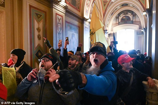 Five died in the violent storming of the Capitol on Wednesday, pictured above