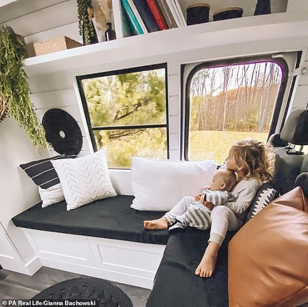The bus now works as a fully-functioning home and has beds, a wet room and toilet, an oven, a stove, heating and solar panels (Luna and Capri pictured)