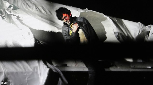 Dzhokhar Tsarnaev leans over in a boat at the time of his capture by law enforcement authorities in Watertown, Massachusetts, on April 19, 2013