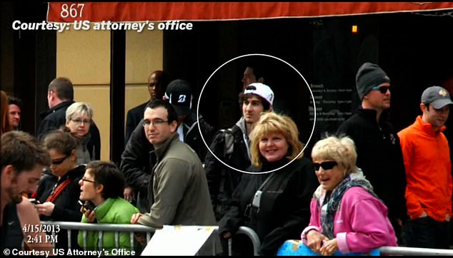 In his lawsuit, Tsarnaev complaints that his white baseball cap and bandanna had been confiscated by prison staff for being disrespectful. The 26-year-old infamously wore a white Polo hat on the day of the bombings in 2013 (circled)