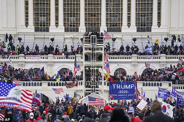 Trump supporters gather outside the Capitol, Wednesday, Jan. 6, 2021, in Washington. As Congress prepares to affirm President-elect Joe Biden's victory, thousands of people have gathered to show their support for President Donald Trump and his claims of election fraud