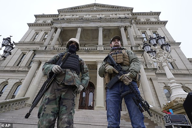 MISSOURI:Armed men stand on the steps at the State Capitol after a rally in support of President Donald Trump