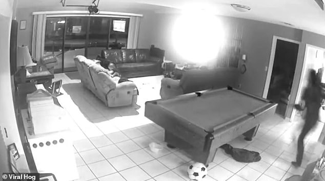 Footage taken in Ocala, Florida, last month shows the toddler playing on the chair before her mother (far right) rushes over to catch her as she topples
