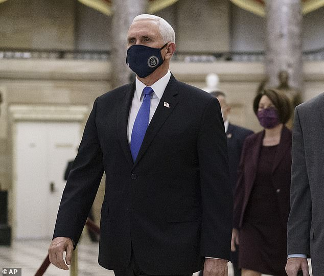 Pelosi applied pressure to Vice President Mike Pence and urged him to invoke the 25th Amendment to remove Trump from office. Both Democrat leaders called Pence to demand Trump's removal from office - but were put on hold. Pence is pictured Thursday being escorted to the House Chamber