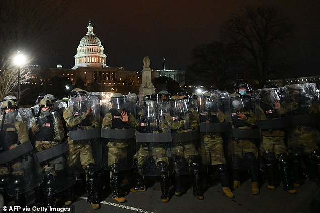 National Guard troops clear a street from protestors outside the Capitol building on January 6, 2021 in Washington, DC after the mayor imposed a curfew. There were problems activating Guard and getting them in proper gear in a timely manner