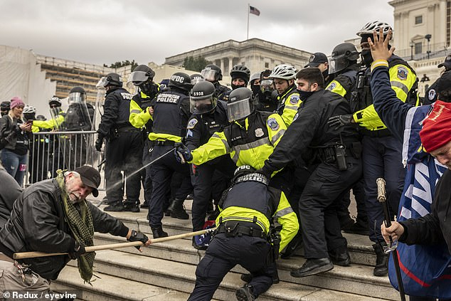 Supporters of President Trump who are trying to overthrow the results of the 2020 presidential election clash with police as the crowd storms up the west side steps of the US Capitol during the session where members of Congress certify the election