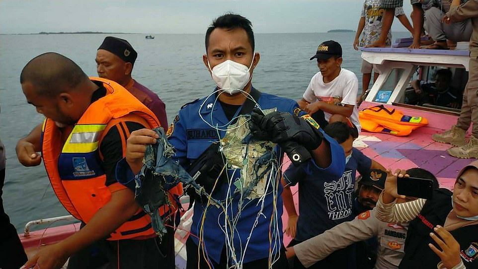 Families of the passengers and crew are fearing the worse after rescuers looking for the jet say they have discovered suspected debris in the ocean north of the capital.