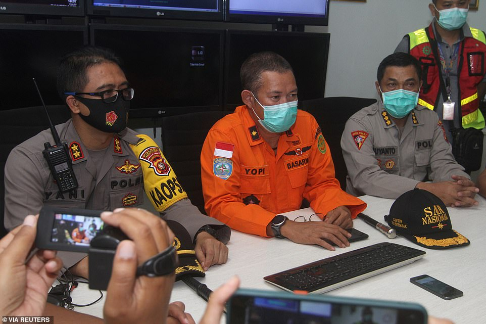 Officials in Pontianak in West Kalimantan address the press after the flight - with 62 people on board - went missing over the Java Sea