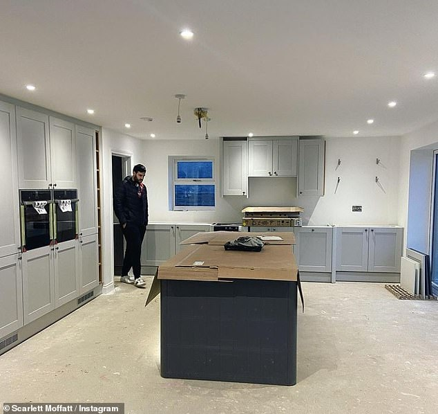 Looking good: Showing off her spacious kitchen, the renovations in her dream home seemed to be coming along nicely as a large island and kitchen cabinets had already been put in place