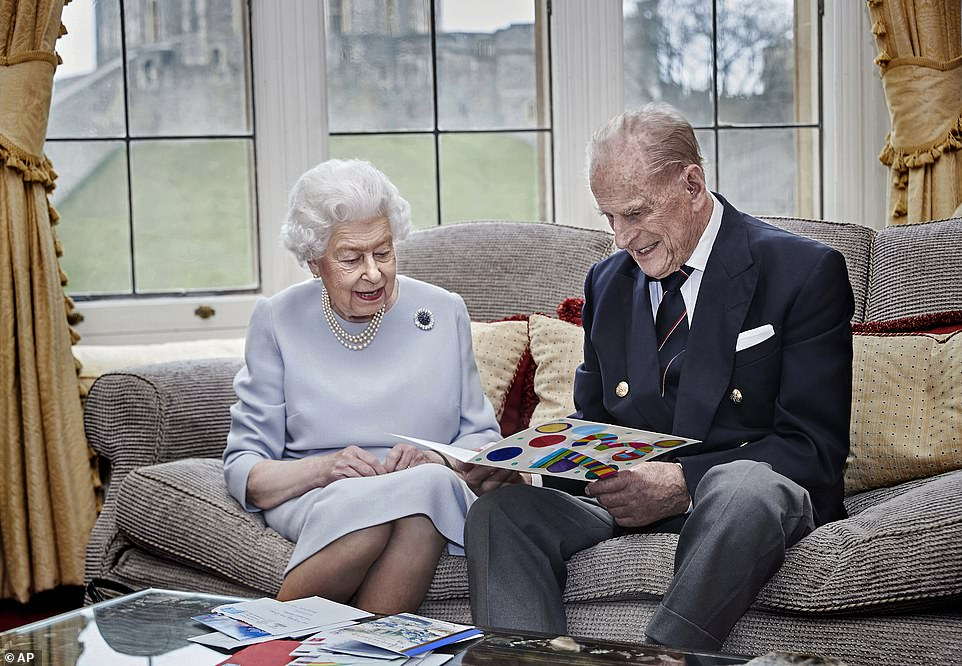 As Boris Johnson announced an ambitious 'test and jabs' blitz to combat the virus, Her Majesty, 94, and the Duke of Edinburgh (pictured in November), 99, received their injections at Windsor Castle from a doctor in the Royal Household