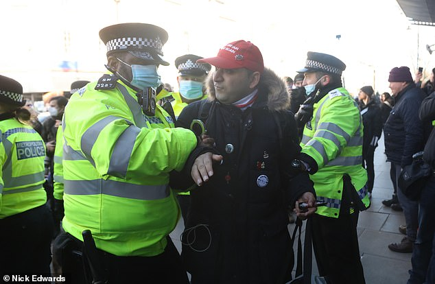 After reaching the Argos store in Clapham, a video which was broadcast online showed brief scuffles between protesters and police as officers appeared to arrest one man. At least 10 officers could be seen surrounding the protesters