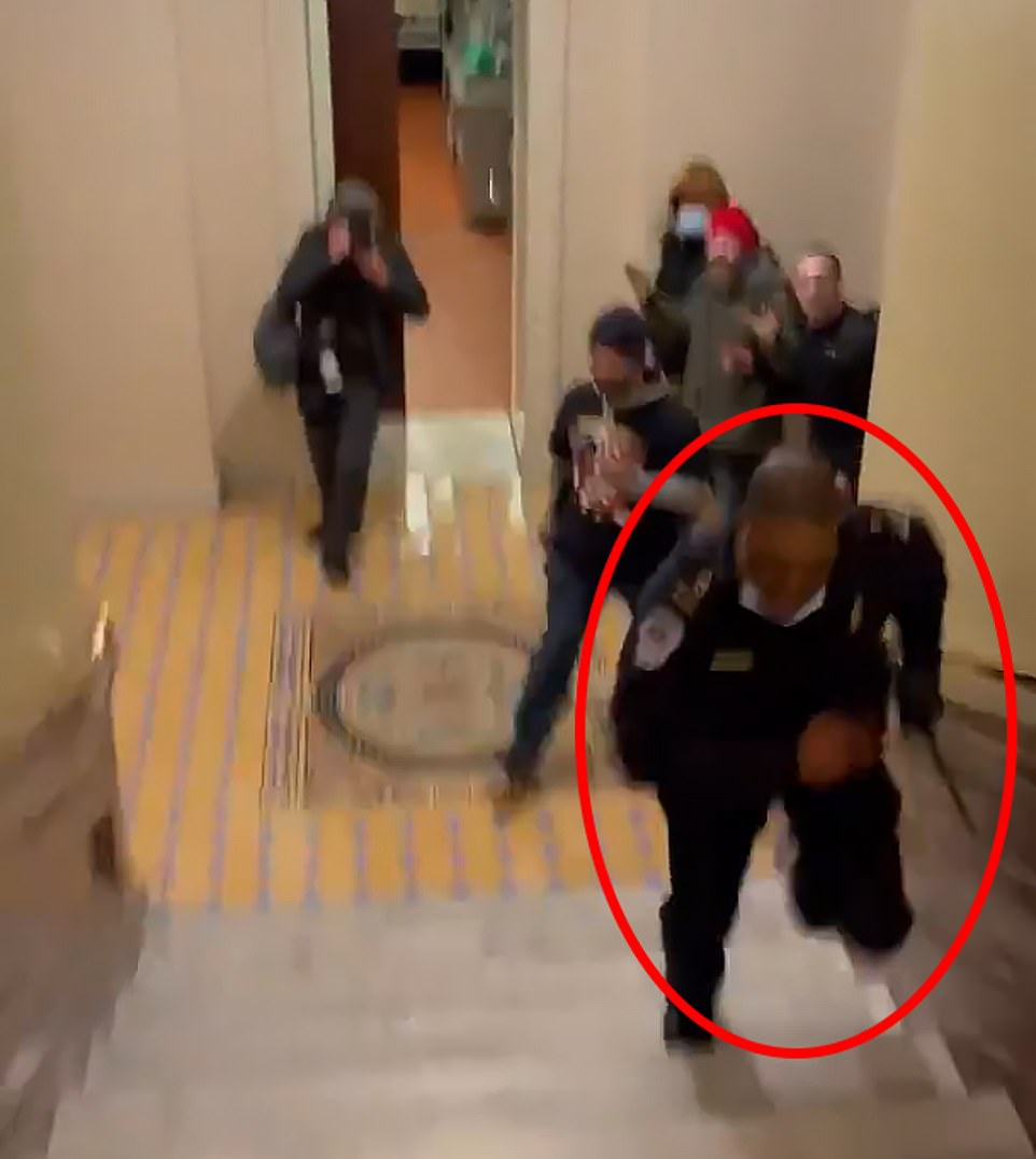 Eugene Goodman is seen running away from the mob, leading them from the Senate