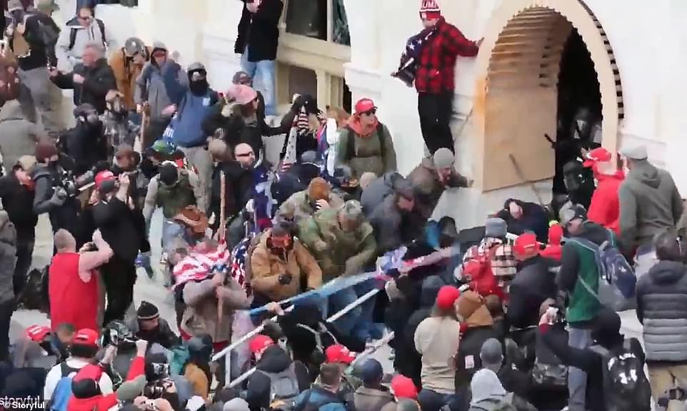 Rioters scaled the walls and dragged one officer outside, beating him with flags and flagpoles