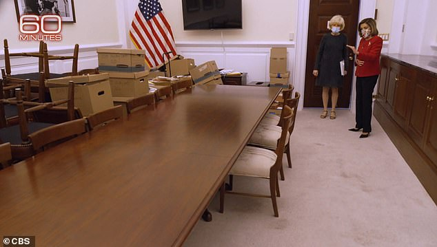 Pelosi's employees cowered under this table in the dark for two hours as the mob roamed