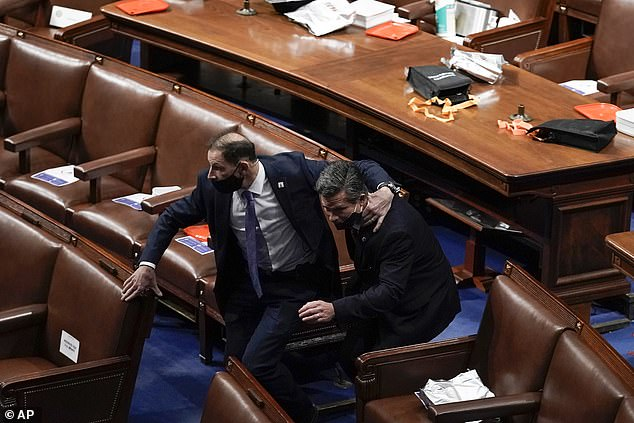 Lawmakers were forced to evacuate the House and Senate chambers and shelter in offices or other locations on Wednesday after thousands of Donald Trump's supporters breached the Capitol and rioted through the halls