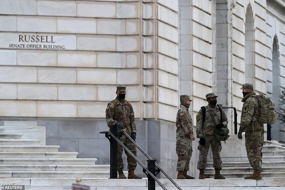 Deputy DHS Secretary Ken Cuccinelli on Thursday insisted that the previous day's Capitol breach would be a 'one time event' and assured that Inauguration Day will be kept under control. Pictured: National Guardsmen gather on Monday