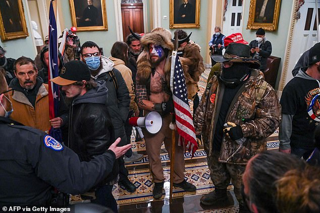 Police officers try to stop supporters of President Donald Trump entering the Capitol