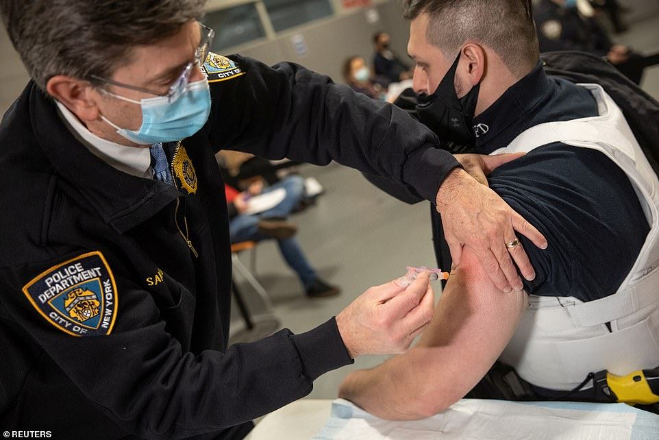 Also on Monday Cuomo opened up the state's vaccine eligibity to essential workers and individuals over the age of 75. A member of the NYPD gets vaccinated above at the Queens Police Academy on Monday
