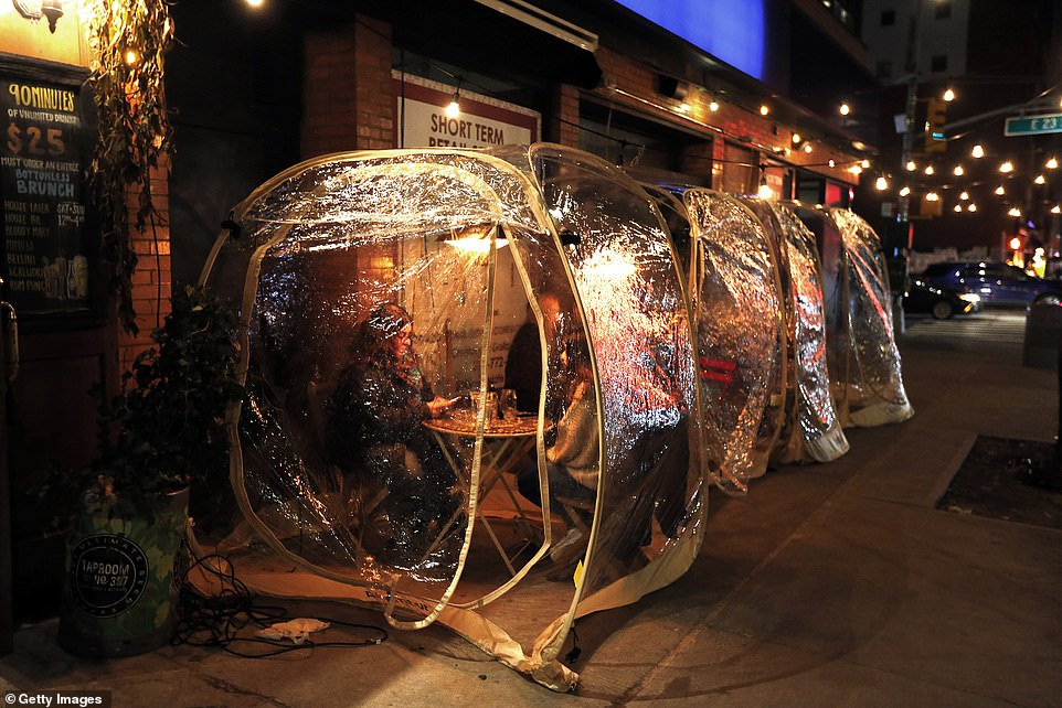 A creative solution: People dine inside plastic igloos outside the Tap Room on the East Side on December 26 in New York City