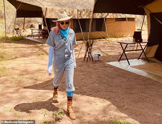 Madonna (pictured in Kenya this week) has reportedly visited five countries in just three weeks clocking up a massive 11,707 air miles, despite Covid travel bans