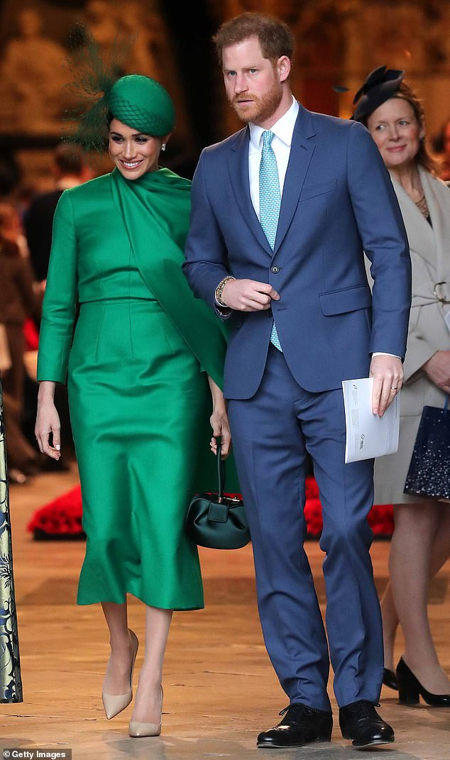 Making a change? Harry (pictured with Meghan in March) has worn his hair in much the same style for years