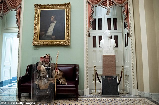 Mostofsky was photographed sitting inside the Capitol building during the riot on Wednesday