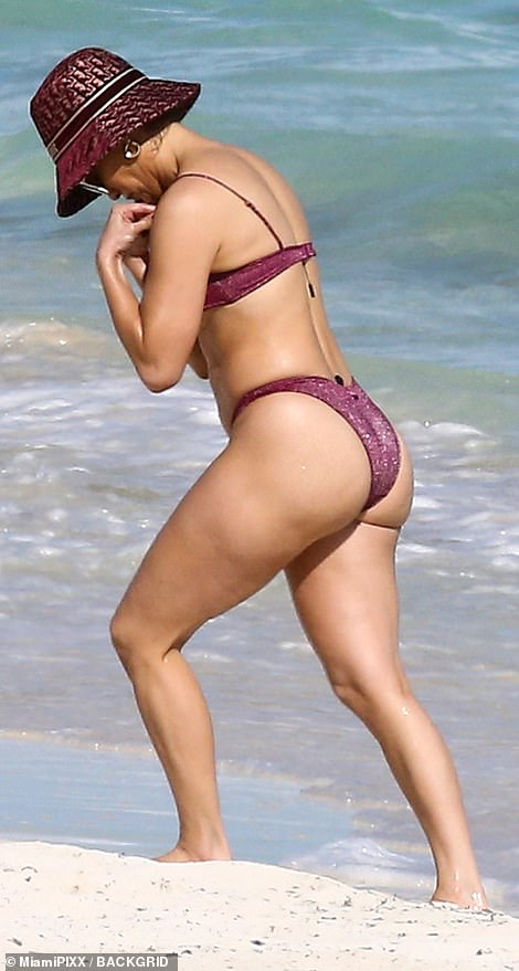 Forget something? JLo forgot to cut off the tag to her bikini, which dangled off the top