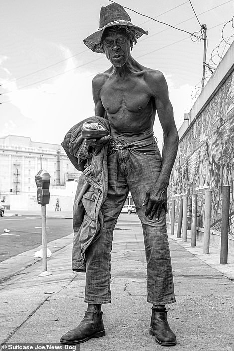 A man known asMel poses for the camera while shirtless on Skid Row