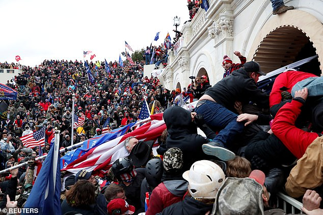The protesters used flag poles and other objects to break doors and windows around the Capitol building