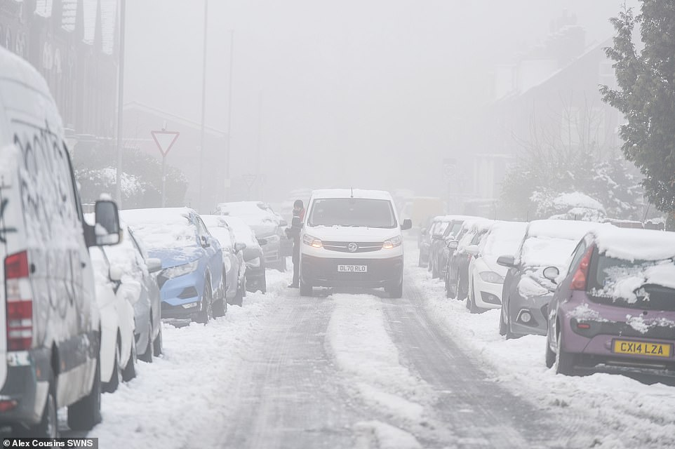A van stops in the snow in Leeds this morning as hazardous conditions continue to affect motorists in West Yorkshire