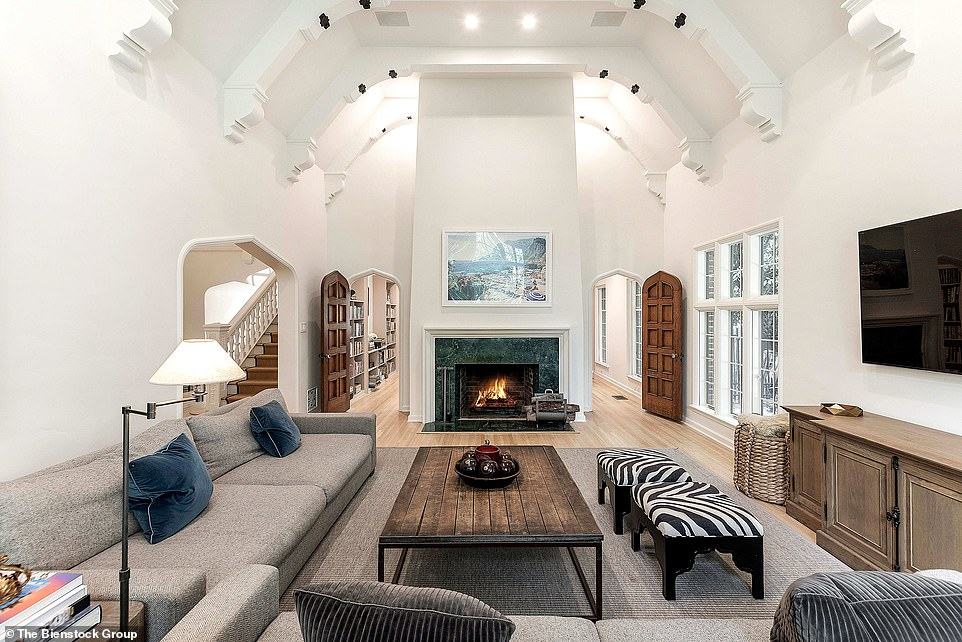 Old world with a modern touch: There are beams on the ceilings that are painted white with black accents as well
