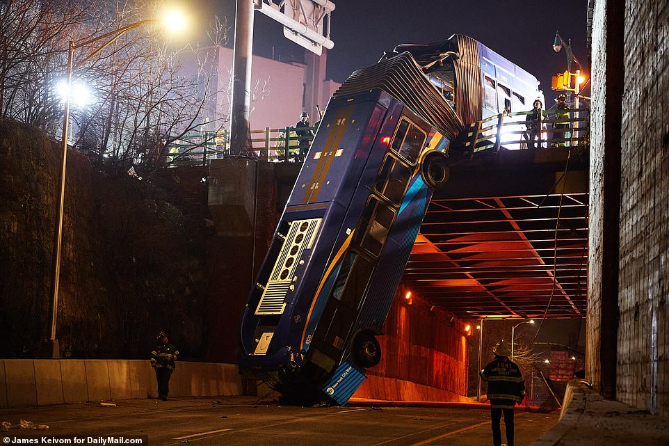 FDNY officials said that the bus fell '50 feet onto the access road,' with the eight injured suffering injuries consistent with falling such a height