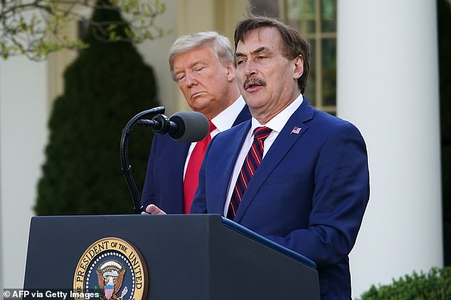 US President Donald Trump listens as Michael J. Lindell, CEO of MyPillow Inc., speaks during the daily briefing on the novel coronavirus, COVID-19, in the Rose Garden of the White House in Washington, DC, on March 30, 2020