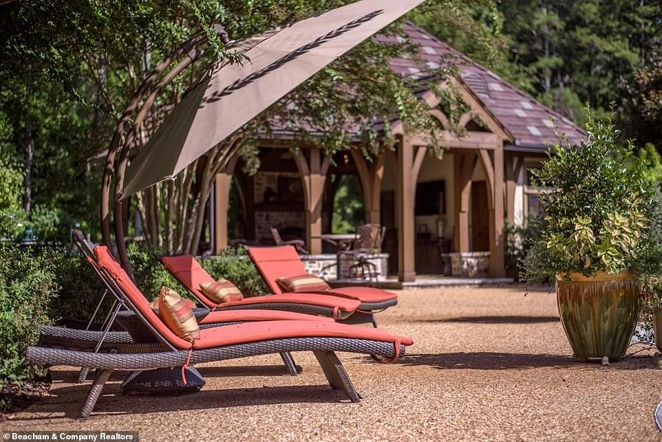 Wonderful:Nearby there is a pool pavilion with attractive country chic pillars and a shingled roof, as well as stone accents that emphasize the feeling of the French countryside