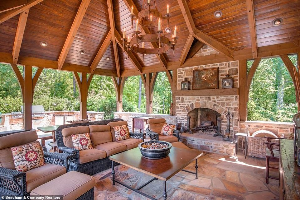 Lap of luxury:The pavilion comes with luxurious patio furniture and even a chandelier and fireplace