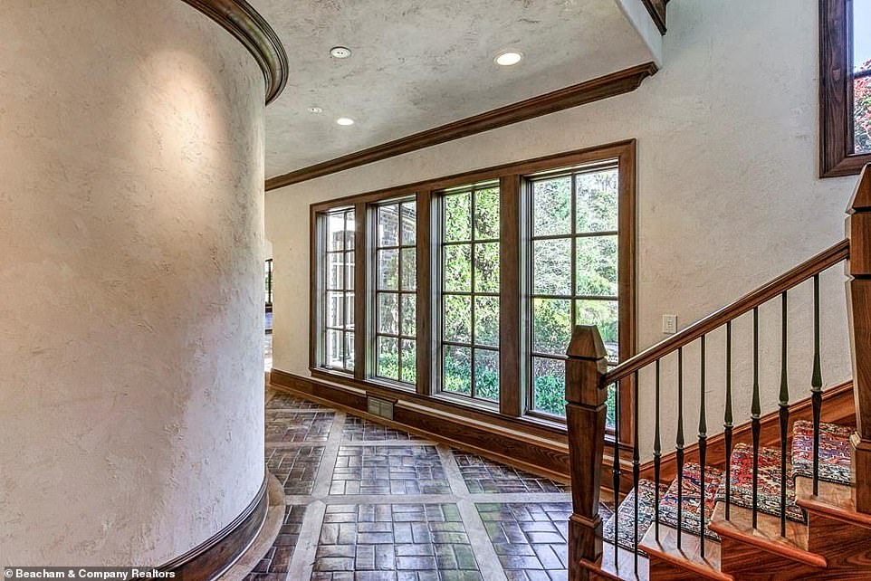 However: Some of the property also has attractive dark brick floors, including a narrow curved hallway that leads to one of the mansion's staircases