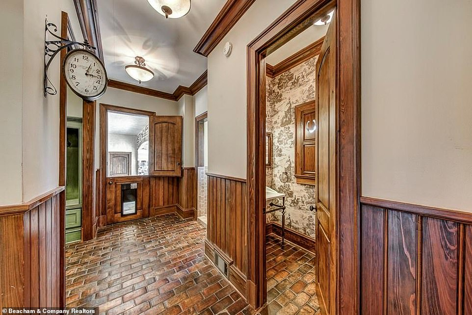 So cute:One of the charming Old World flourishes of the house is an antique-style clock hanging on one of the walls, right in sight of a Dutch door that has a doggy-door cut into it