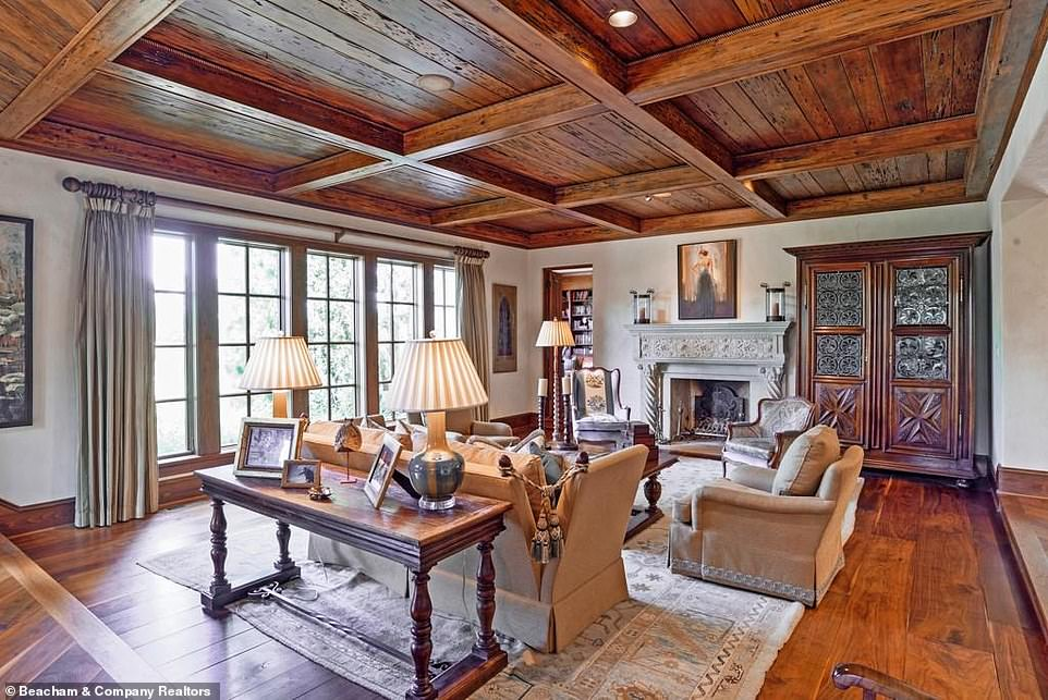Swank:On the other side of the room from the piano there is a small fireplace with a pale blue mantelpiece that has been carved with intricate floral patterning