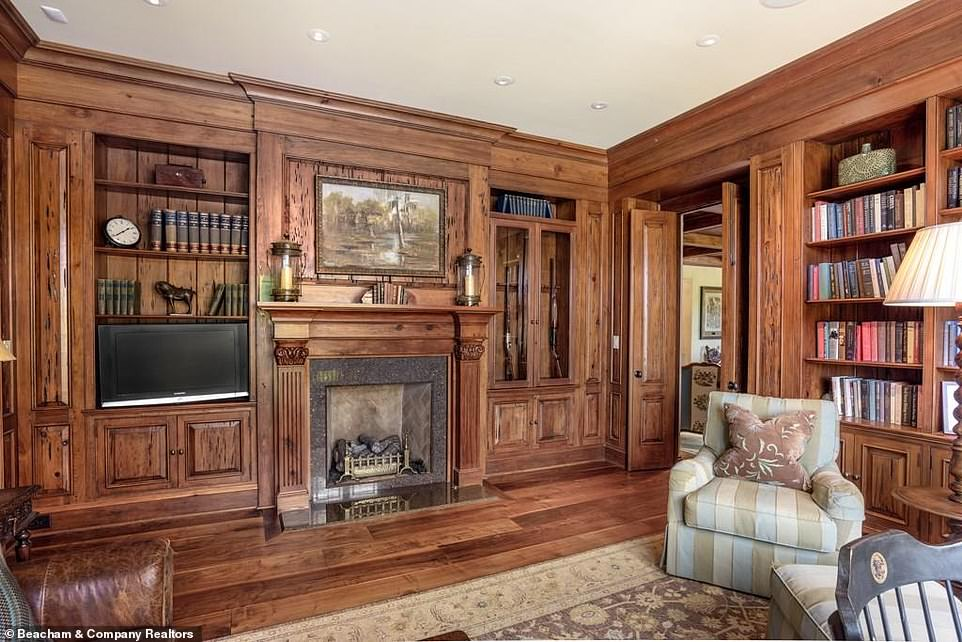 Complete with the trappings:When the furniture was put into the library some of the accents included a television set that managed to fit into one of the shelves, as well as a landscape painting over the fireplace