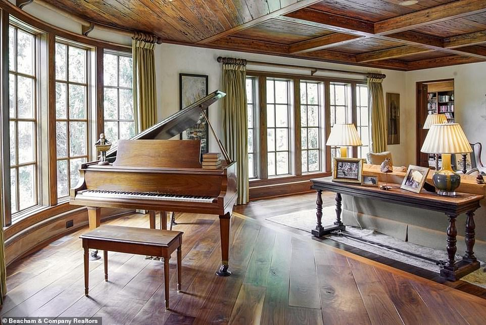 Artistic:Dwayne's rambling country home in Georgia also has a few sitting rooms - one of which is furnished with a baby grand piano behind the sofas
