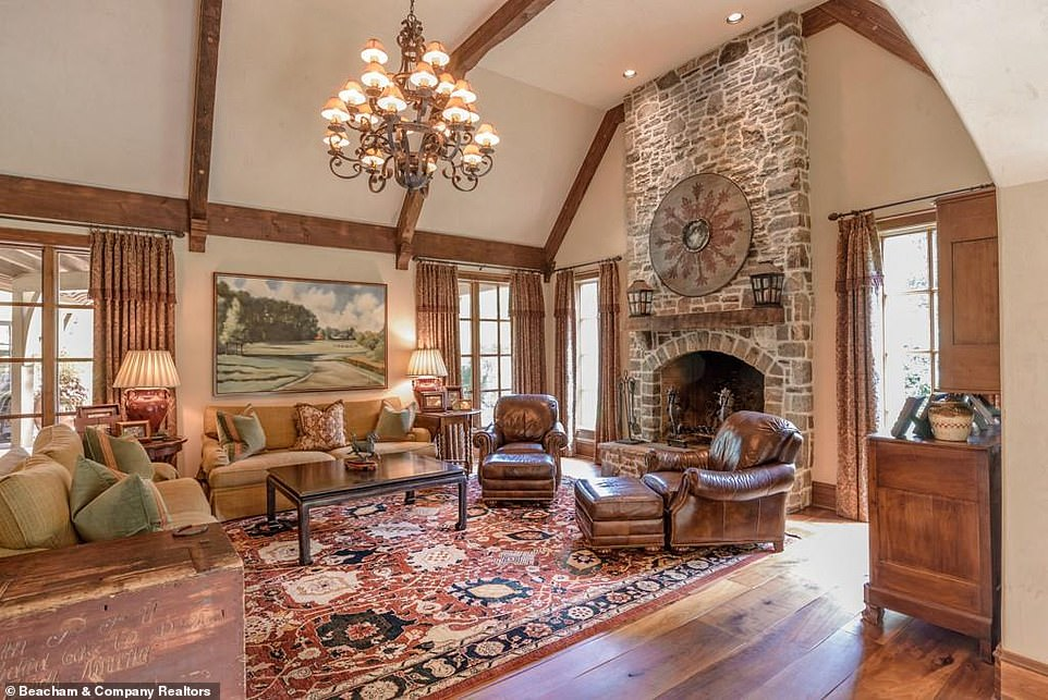 How the other half live:In that room what appears to be an old round shield is hung over the mantelpiece, just above two comfortable-looking leather armchairs with matching ottomans